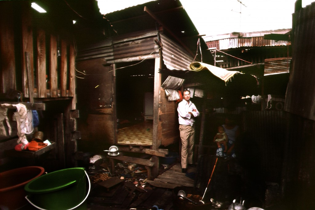 A younger Father Joe standing outside one of his first homes in the Slaughterhouse district of the Klong Toey slums in Bangkok. Photo by Jim Coyne, 1983.
