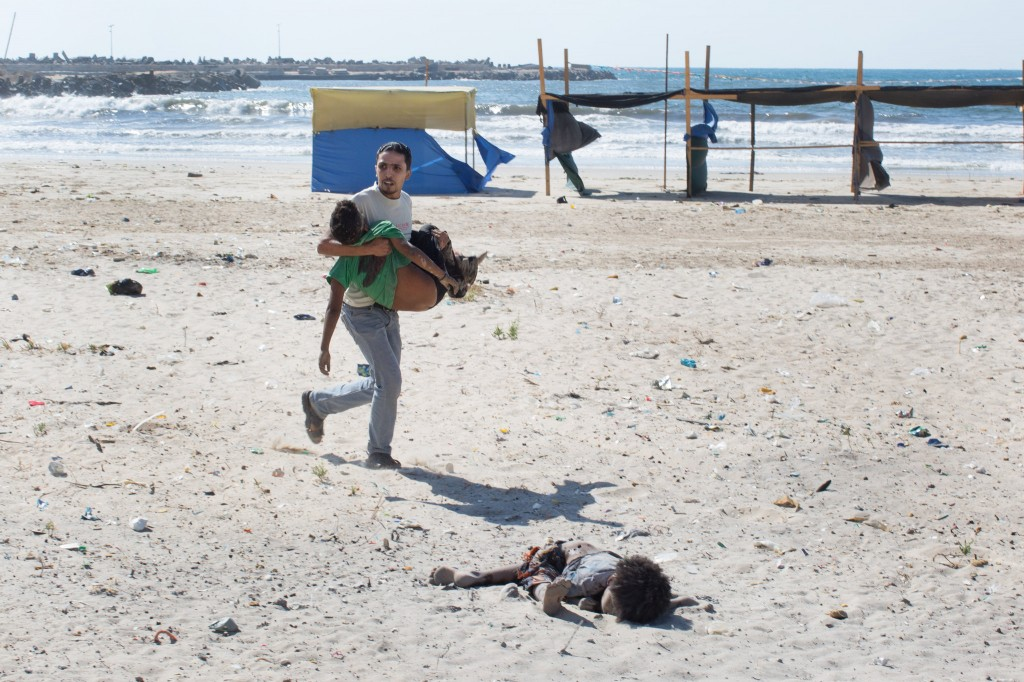 Credit: Tyler Hicks, New York Times. The aftermath of an airstrike on a beach in Gaza City. Four young Palestinian boys, all cousins, were killed.